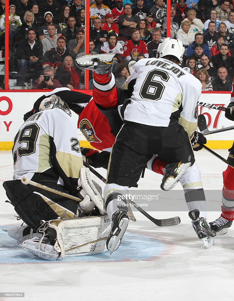 Erik Condra #22 of the Ottawa Senators is upended while going to the net by Ben Lovejoy #6 and <a gi-track='captionPersonalityLinkClicked' href=/galleries/search?phrase=Marc-Andre+Fleury&family=editorial&specificpeople=233779 ng-click='$event.stopPropagation()'>Marc-Andre Fleury</a> #29 of the Pittsburgh Penguins on January 27, 2013 at Scotiabank Place in Ottawa, Ontario, Canada.