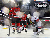 Erik Condra of the Ottawa Senators reacts after getting hit with a puck during the game against the New Jersey Devils at the Prudential Center on...