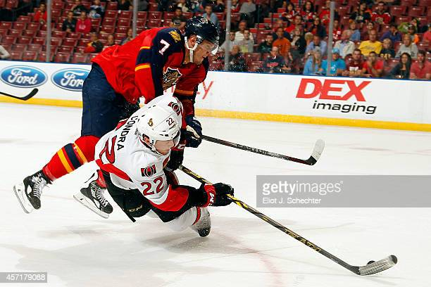 Erik Condra of the Ottawa Senators shoots the puck against Dmitry Kulikov of the Florida Panthers during the second period at the BBT Center on...