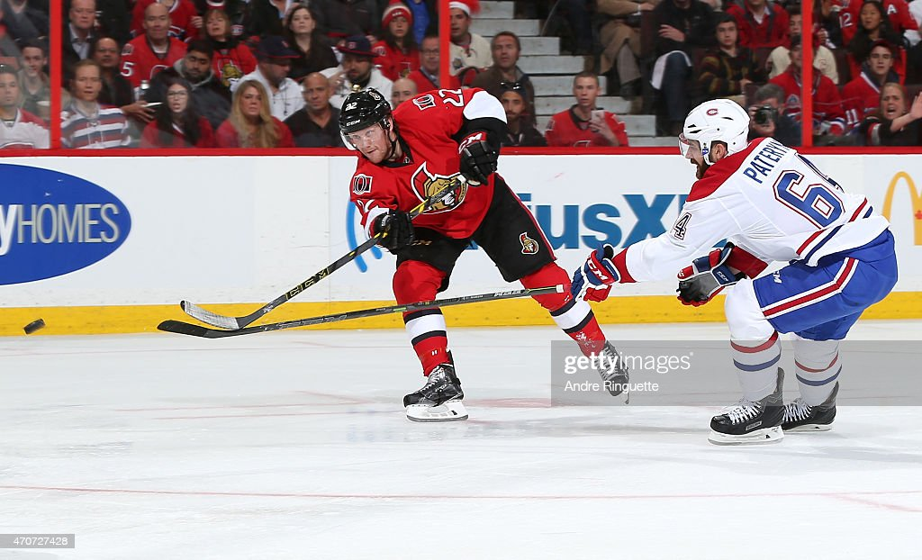 Erik Condra of the Ottawa Senators shoots the puck against Greg Pateryn of the Montreal Canadiens in Game Four of the Eastern Conference...