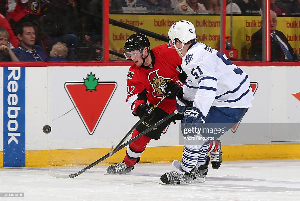 <a gi-track='captionPersonalityLinkClicked' href=/galleries/search?phrase=Erik+Condra&family=editorial&specificpeople=6254234 ng-click='$event.stopPropagation()'>Erik Condra</a> #22 of the Ottawa Senators shoots the puck against <a gi-track='captionPersonalityLinkClicked' href=/galleries/search?phrase=Jake+Gardiner&family=editorial&specificpeople=4884939 ng-click='$event.stopPropagation()'>Jake Gardiner</a> #51 of the Toronto Maple Leafs at Canadian Tire Centre on April 12, 2014 in Ottawa, Ontario, Canada.