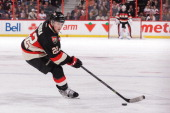 Erik Condra of the Ottawa Senators skates against the Detroit Red Wings during an NHL game at Canadian Tire Centre on February 27 2014 in Ottawa...