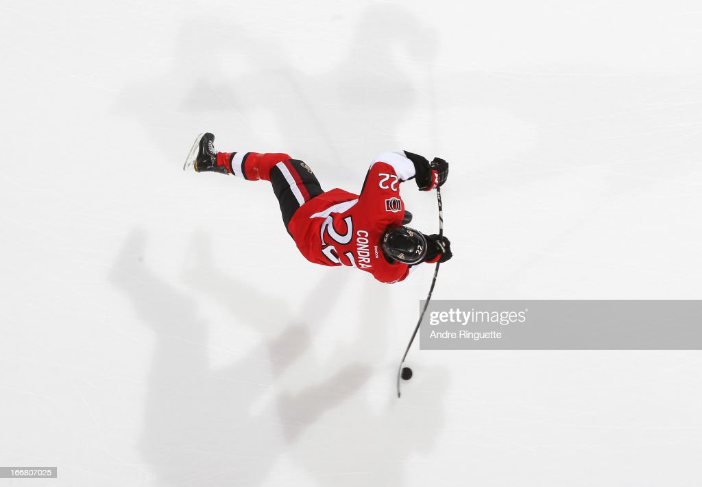 <a gi-track='captionPersonalityLinkClicked' href=/galleries/search?phrase=Erik+Condra&family=editorial&specificpeople=6254234 ng-click='$event.stopPropagation()'>Erik Condra</a> #22 of the Ottawa Senators skates against the New York Rangers on March 28, 2013 at Scotiabank Place in Ottawa, Ontario, Canada.