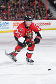 Erik Condra of the Ottawa Senators skates with the puck against the Tampa Bay Lightning at Canadian Tire Centre on January 4 2015 in Ottawa Ontario...