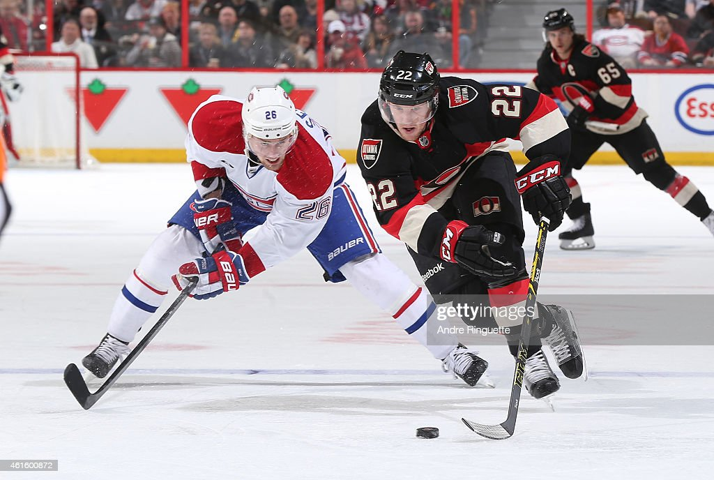 Erik Condra of the Ottawa Senators stickhandles the puck against Jiri Sekac of the Montreal Canadiens at Canadian Tire Centre on January 15 2015 in...