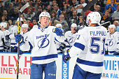 Erik Condra of the Tampa Bay Lightning celebrates his second period goal against the Buffalo Sabres with teammate Valtteri Filppula on October 10...