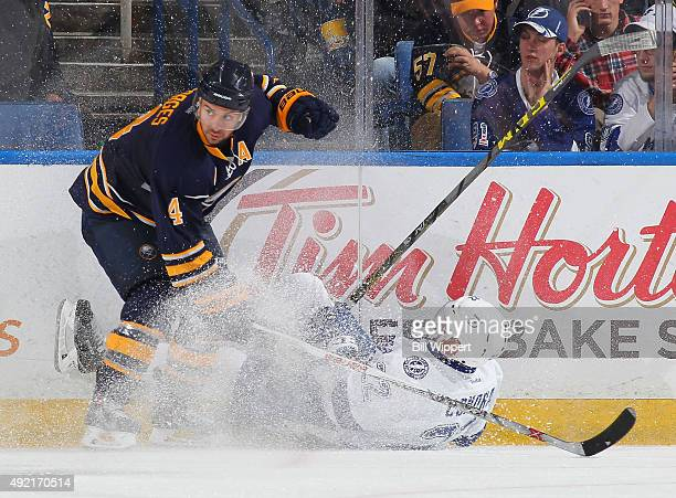 Erik Condra of the Tampa Bay Lightning is upneded by Josh Gorges of the Buffalo Sabres on October 10 2015 at the First Niagara Center in Buffalo New...