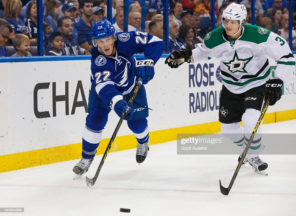 Erik Condra of the Tampa Bay Lightning passes the puck against John Klingberg of the Dallas Stars during the first period at the Amalie Arena on...