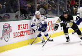 Erik Condra of the Tampa Bay Lightning plays against Ian Cole of the Pittsburgh Penguins during the second period of the NHL Kraft Hockeyville USA...