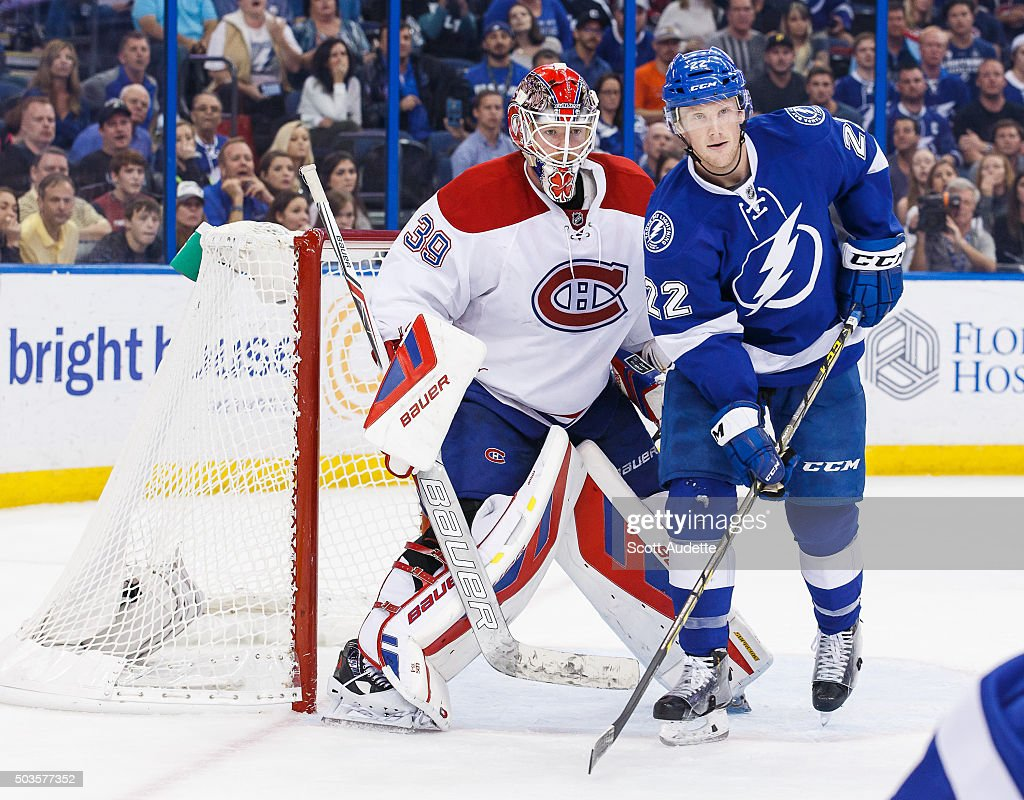 Erik Condra of the Tampa Bay Lightning skates against goalie Mike Condon of the Montreal Canadiens during the third period at the Amalie Arena on...