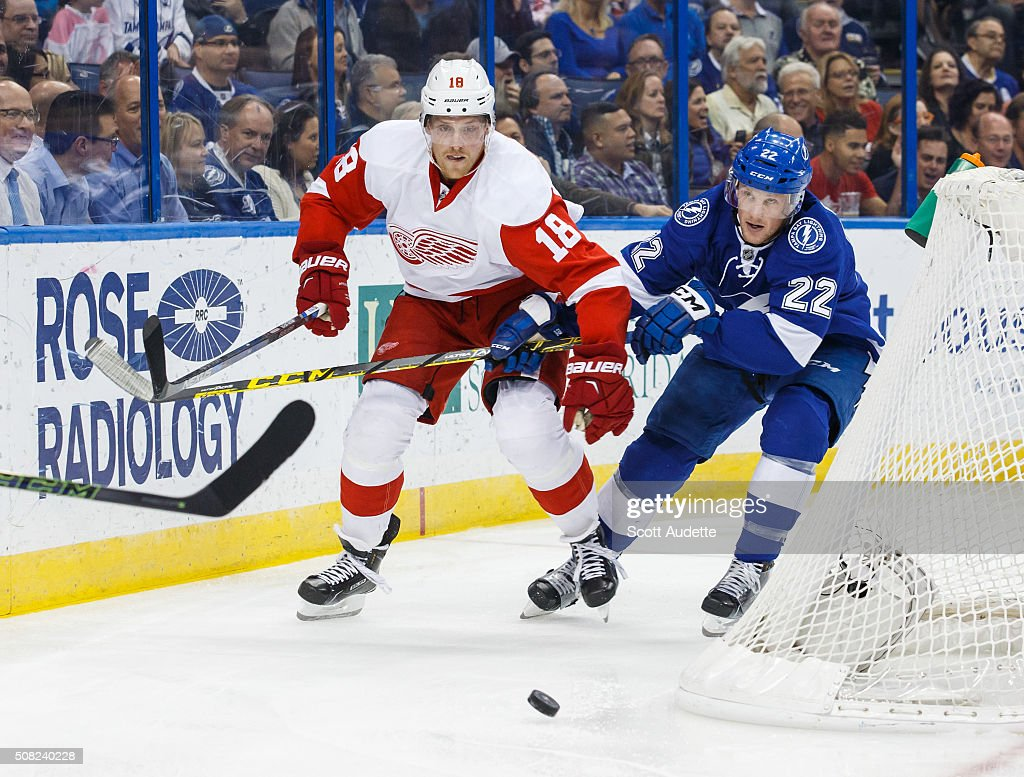 Erik Condra of the Tampa Bay Lightning skates for puck against Joakim Andersson of the Detroit Red Wings during the first period at the Amalie Arena...