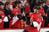 Erik Condra the Ottawa Senators celebrates his third period goal with teammates Chris Phillips and Marc Methot during an NHL game against the Toronto...