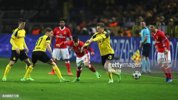 Erik Durm and Lukasz Piszczek of Borussia Dortmund battles for the ball with Franco Cervi of SL Benfica during the UEFA Champions League Round of 16...