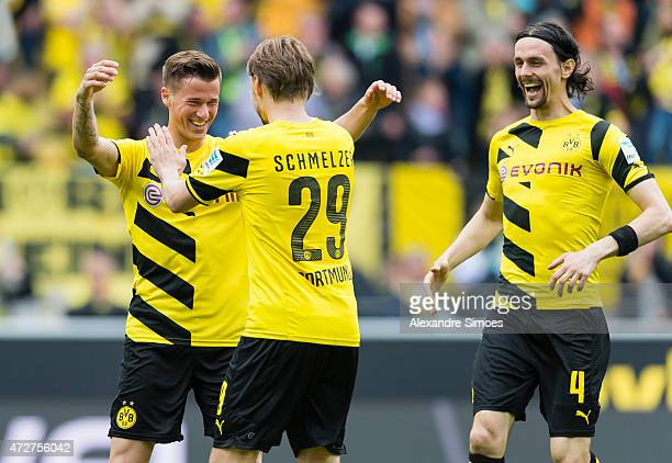 Erik Durm of Borussia Dortmund celebrates scoring the goal to the 20 together with his team mates Marcel Schmelzer and Neven Subotic during the...
