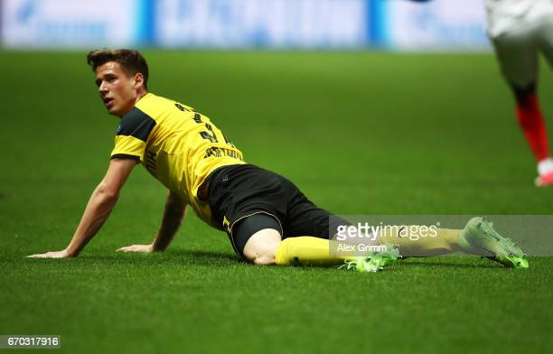 Eric Durm of Borussia Dortmund is dejected during the UEFA Champions League Quarter Final second leg match between AS Monaco and Borussia Dortmund at...