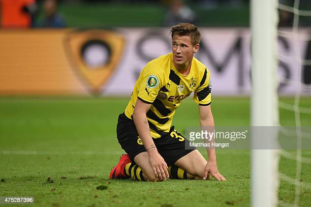 Erik Durm of Borussia Dortmund reacts during the DFB Cup Final match between Borussia Dortmund and VfL Wolfsburg at Olympiastadion on May 30 2015 in...