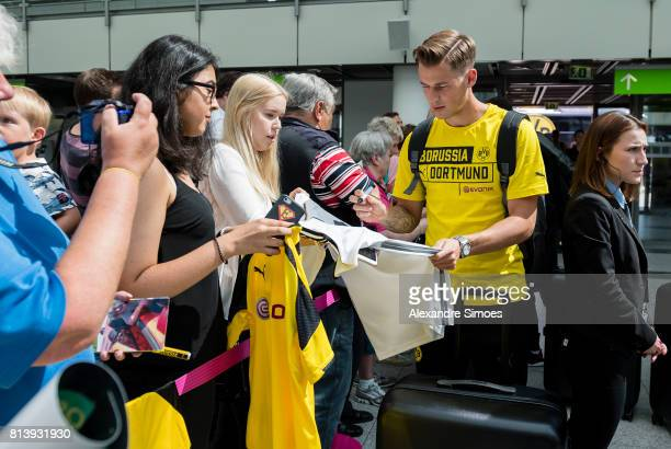 Erik Durm of Borussia Dortmund together with fans at the Airport before flying to Japan on July 13 2017 in Dortmund Germany