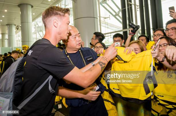 Erik Durm of Borussia Dortmund together with the chinese fans which are welcoming the team at the airport during the Borussia Dortmund Summer Tour in...