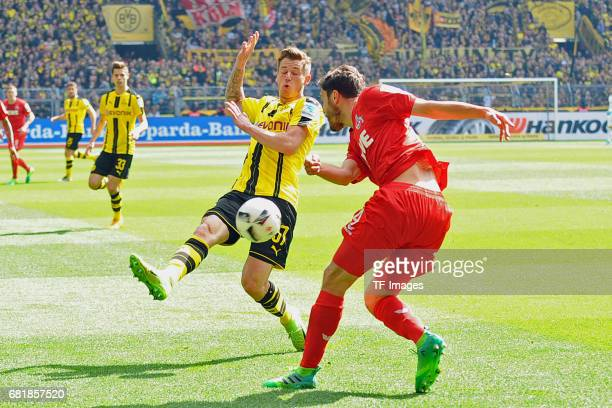 Erik Durm of Dortmund and Jonas Hector of Colonge battle for the ball during the Bundesliga match between Borussia Dortmund and FC Koeln at Signal...