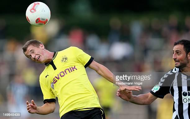 Erik Durm of Dortmund and Josef Cinar of Burghausen battle for the ball during the 3 Liga match between Borussia Dortmund II and Wacker Burghausen at...