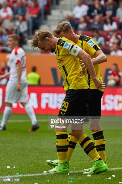 Erik Durm of Dortmund and Marcel Schmelzer of Dortmund looks on during the Bundesliga match between FC Augsburg and Borussia Dortmund at the WWKArena...