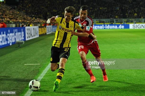 Erik Durm of Dortmund and Markus Suttner of Ingolstadt battle for the ball during the Bundesliga match between Borussia Dortmund and FC Ingolstadt 04...