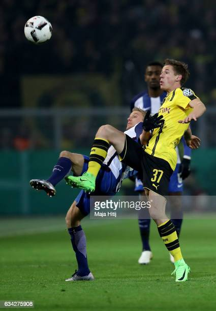 Erik Durm of Dortmund and Per Skjelbred of Berlin battle for the ball during the DFB Cup Round of 16 match between Borussia Dortmund and Hertha BSC...