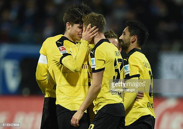 Erik Durm of Dortmund celebrates with his teammate Julian Weigl of Dortmund after scoring his team's second goal during the Bundesliga match between...