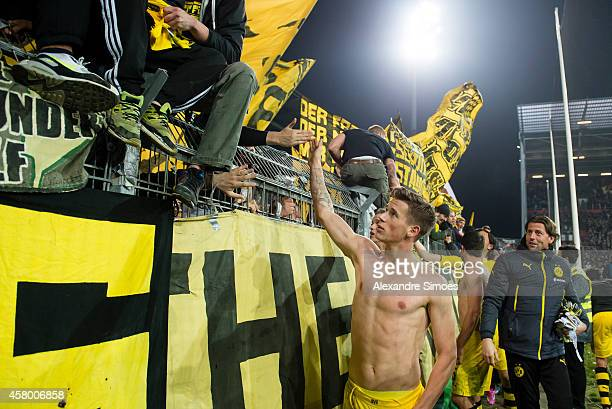 Erik Durm of Dortmund celebrates with the fans after the final whistle during the DFB Cup 2 round match between FC St Pauli and Borussia Dortmund at...