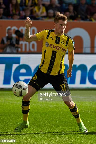 Erik Durm of Dortmund controls the ball during the Bundesliga match between FC Augsburg and Borussia Dortmund at the WWKArena on May 13 2017 in...