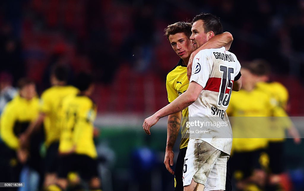 <a gi-track='captionPersonalityLinkClicked' href=/galleries/search?phrase=Erik+Durm&family=editorial&specificpeople=8218660 ng-click='$event.stopPropagation()'>Erik Durm</a> (L) of Dortmund hugs former team mate <a gi-track='captionPersonalityLinkClicked' href=/galleries/search?phrase=Kevin+Grosskreutz&family=editorial&specificpeople=4265546 ng-click='$event.stopPropagation()'>Kevin Grosskreutz</a> of Stuttgart during the DFB Cup Quarter Final match between VfB Stuttgart and Borussia Dortmund at Mercedes-Benz Arena on February 9, 2016 in Stuttgart, Germany.