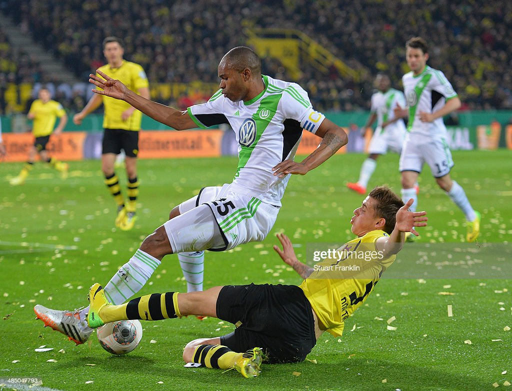 Erik Durm of Dortmund is challenged by Naldo of Wolfsburg during the DFB Cup semi final match between Borussia Dortmund and VfL Wolfsburg at Signal Iduna Park on April 15, 2014 in Dortmund, Germany.