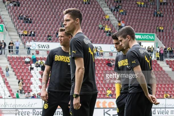 Erik Durm of Dortmund Julian Weigl of Dortmund Marc Bartra of Dortmund Christian Pulisic of Dortmund looks on during the Bundesliga match between FC...