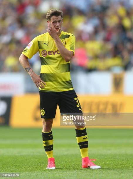 Erik Durm of Dortmund looks thoughtful during the preseason friendly match between RotWeiss Essen and Borussia Dortmund at Stadion Essen on July 11...
