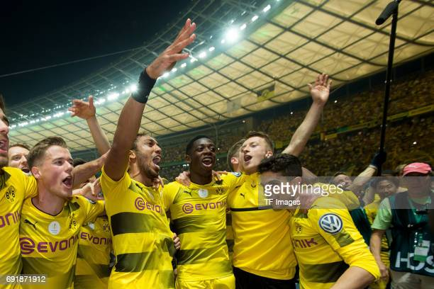 Erik Durm of Dortmund PierreEmerick Aubameyang of Dortmund Ousmane Dembele of Dortmund Marco Reus of Dortmund and Marc Bartra of Dortmund celebrates...