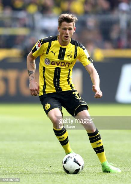 Erik Durm of Dortmund runs with the ball during the Bundesliga match between Borussia Dortmund and 1 FC Koeln at Signal Iduna Park on April 29 2017...