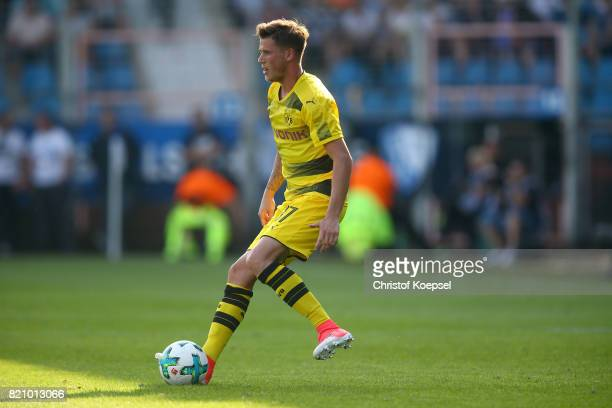 Erik Durm of Dortmund runs with the ball during the preseason friendly match between VfL Bochum and Borussia Dortmund at Vonovia Ruhrstadion on July...