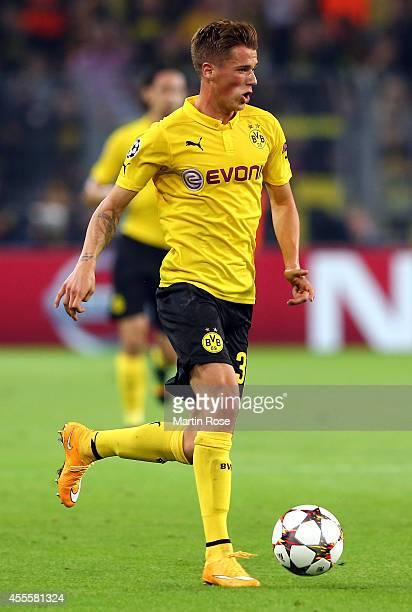 Erik Durm of Dortmund runs with the ball the UEFA Champions League Group D match between Borussia Dortmund and Arsenal London at Signal Iduna Parkon...