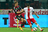 Erik Durm of Germany battles for the ball with Robert Lewandowski of Poland during of the EURO 2016 Group D qualifying match between Poland and...