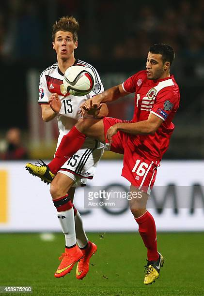 Erik Durm of Germany is challenged by Brian Perez of Gibraltar during the EURO 2016 Group D Qualifier match between Germany and Gibraltar at Grundig...