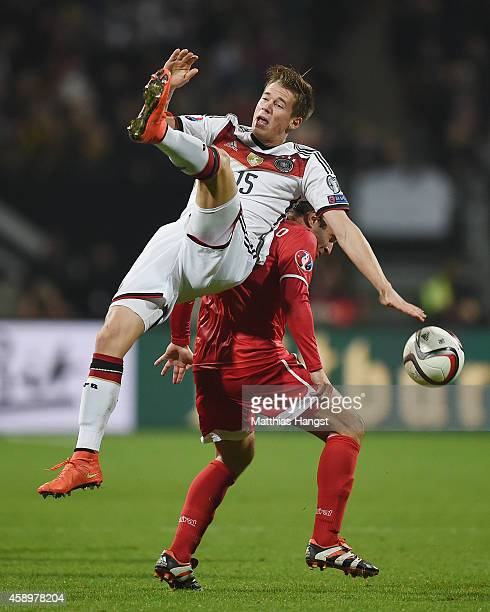 Erik Durm of Germany jumps for a header with Lee Casciaro of Gibraltar during the EURO 2016 Group D Qualifier match between Germany and Gibraltar at...