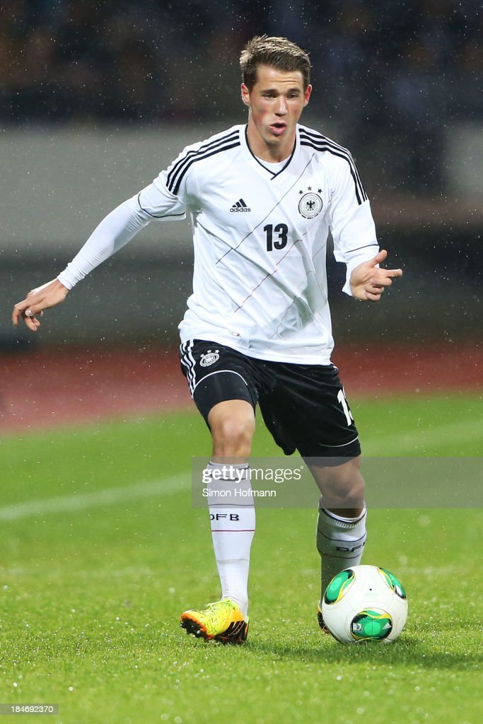 <a gi-track='captionPersonalityLinkClicked' href=/galleries/search?phrase=Erik+Durm&family=editorial&specificpeople=8218660 ng-click='$event.stopPropagation()'>Erik Durm</a> of Germany runs with the ball during the 2015 UEFA European U21 Championships Qualifying Group Six match between Germany U21 and Faroe Islands U21 at Auestadion on October 15, 2013 in Kassel, Germany.
