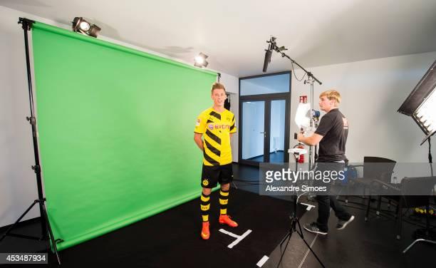 Erik Durm poses during the Borussia Dortmund team presentation on August 11 2014 in Dortmund Germany
