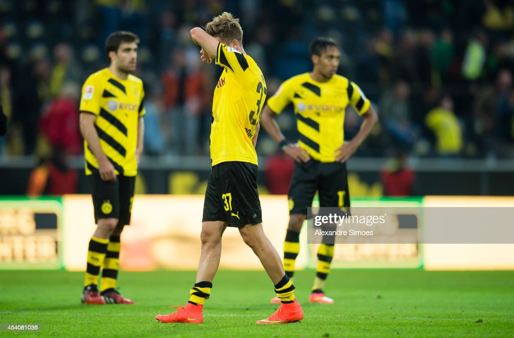 <a gi-track='captionPersonalityLinkClicked' href=/galleries/search?phrase=Erik+Durm&family=editorial&specificpeople=8218660 ng-click='$event.stopPropagation()'>Erik Durm</a> (BVB), with Sokratis Papastathopoulos (BVB) and Pierre-Emerick Aubameyang (BVB) react after the Bundesliga match between Borussia Dortmund and Bayer 04 Leverkusen at Signal Iduna Park on AUGUST 23, 2014 in Dortmund, Germany.