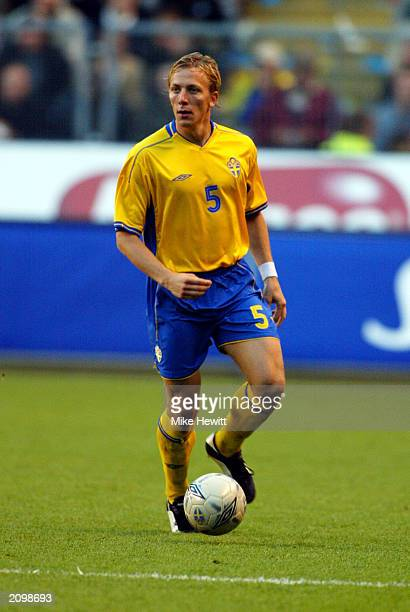Erik Edman of Sweden runs with the ball during the UEFA European Championships 2004 Group 4 Qualifying match between Sweden and Poland held on June...