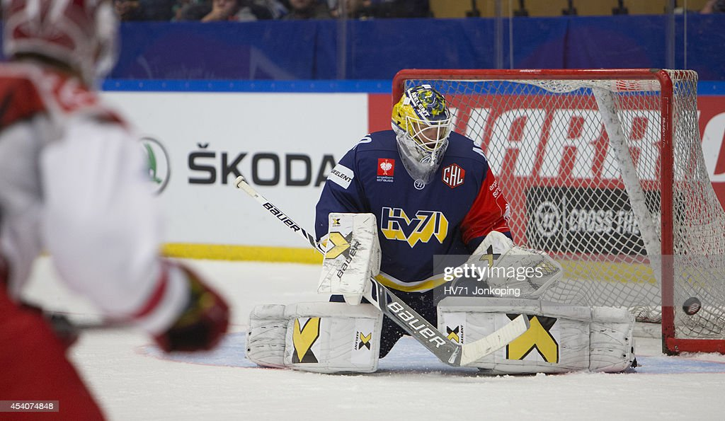 Erik Ersberg #40 Goaltender of HV71 makes a save after a shot on goal from Thomas Raffl #5 of Red Bull Salzburg during the Champions Hockey League group stage game between HV71 Jonkoping and Red Bull Salzburg on August 24, 2014 in Jonkoping, Sweden.