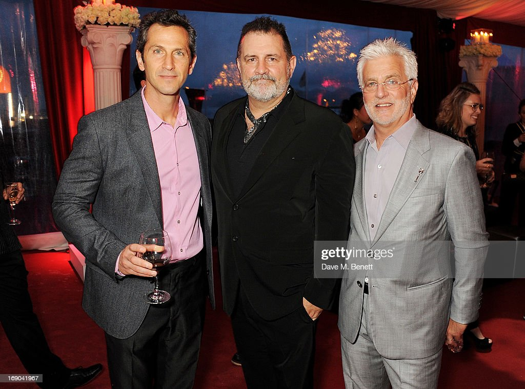 Erik Feig, Tim Palen and Lionsgate Motion Picture Group Co-Chairman <a gi-track='captionPersonalityLinkClicked' href=/galleries/search?phrase=Rob+Friedman&family=editorial&specificpeople=234962 ng-click='$event.stopPropagation()'>Rob Friedman</a> (L) and actress Jennifer Lawrence attend Lionsgate's attend Lionsgate's The Hunger Games: Catching Fire Cannes Party at Baoli Beach sponsored by COVERGIRL on May 18, 2013 in Cannes, France.