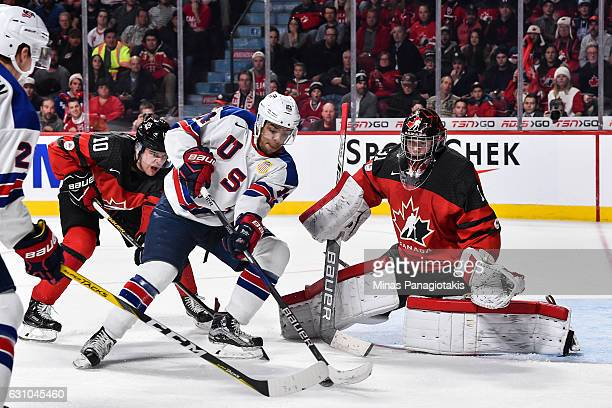 Erik Foley of Team United States tries to get a shot on goaltender Carter Hart of Team Canada during the 2017 IIHF World Junior Championship gold...