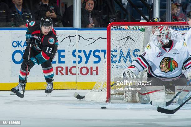 Erik Gardiner of the Kelowna Rockets passes the puck ahead of Cole Kehler of the Portland Winterhawks during third period at Prospera Place on...