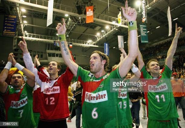 Erik Goethel Silvio Heinevetter Grzegorz Tkaczyk and Christian Sprenger of Magdeburg celebrate after the Handball Bundesliga match between SC...